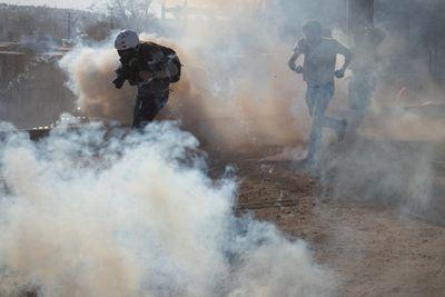 immigrants tear gas running.jpg