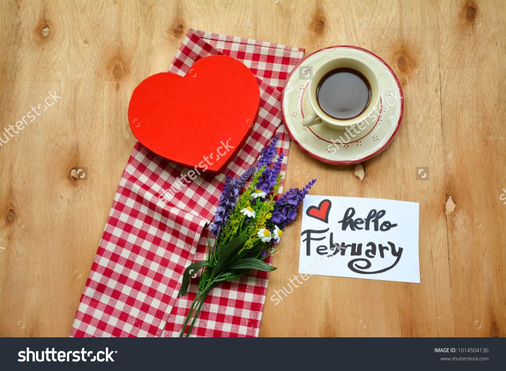 stock-photo-a-cup-of-coffee-and-a-note-with-hello-february-text-on-rustic-wooden-table-and-lavender-flowers-1014504136.jpg