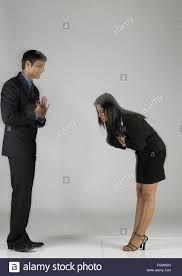 woman bowing to man.jpeg