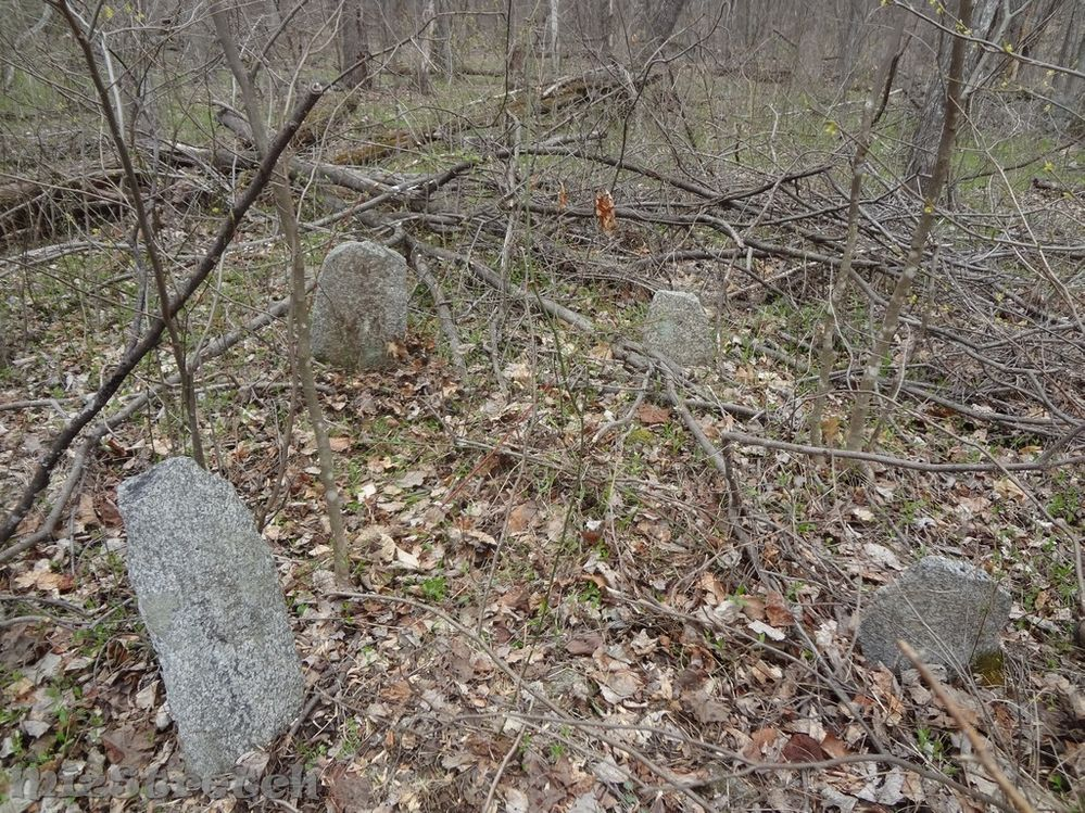 This cemetery had 8-10 burials (possibly more), many marked with smaller fieldstones and one flat marker.  It was 125' behind the double-chimney home.