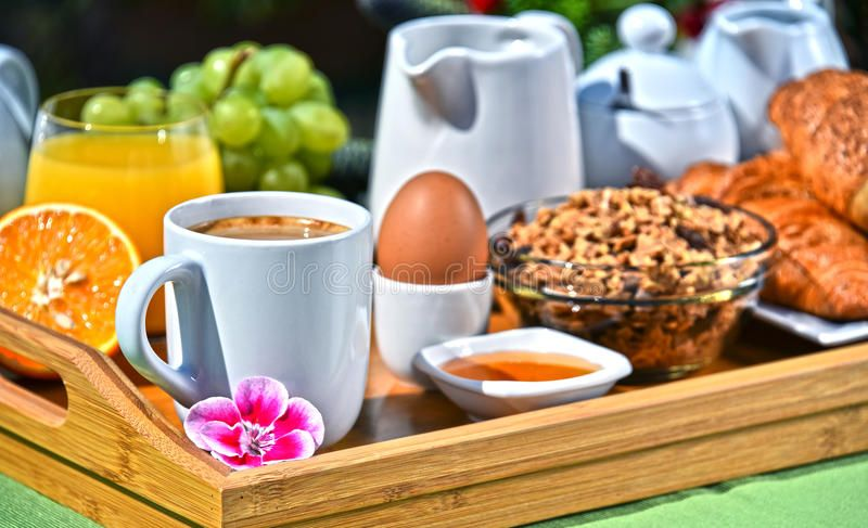 breakfast-served-coffee-juice-croissants-fruits-orange-cereals-garden-95336493.jpg