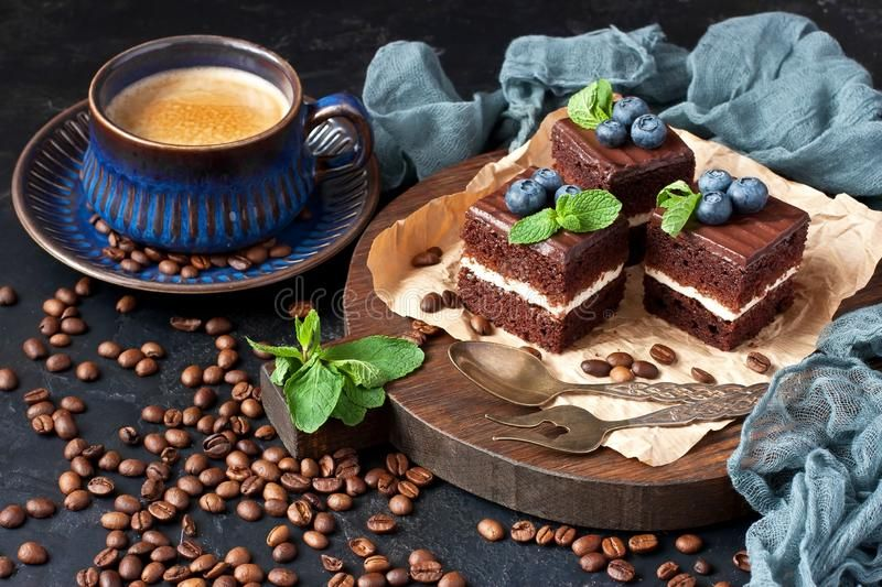 cup-coffee-foam-chocolate-cakes-blueberry-mint-leaves-drink-hot-coffee-cup-slices-chocolate-cakes-139770282.jpg