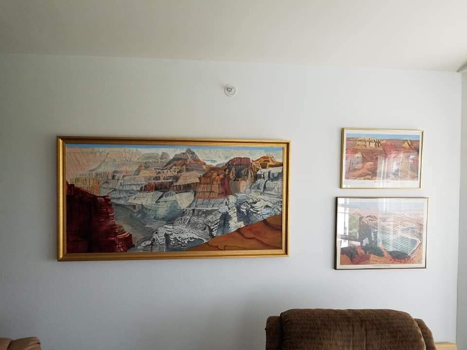 The paint on the left was do by Mary's father