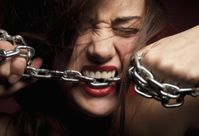 Woman-biting-chain