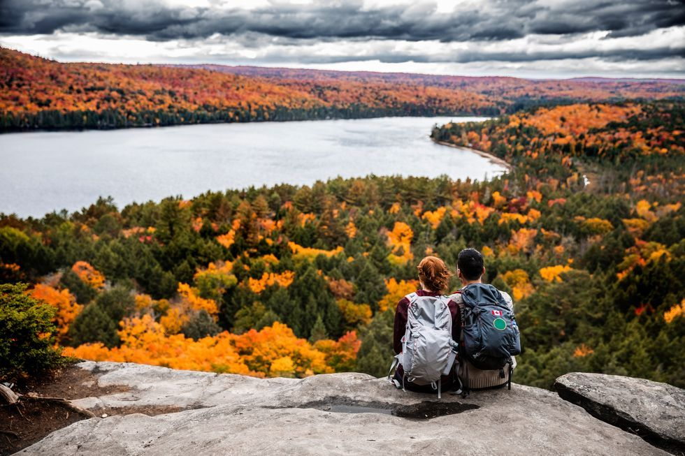 young-couple-hiking-in-mountain-and-relaxing-royalty-free-image-621242410-1567024892.jpg