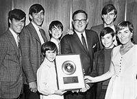 220px-Cowsills_gold_record_1967.jpg