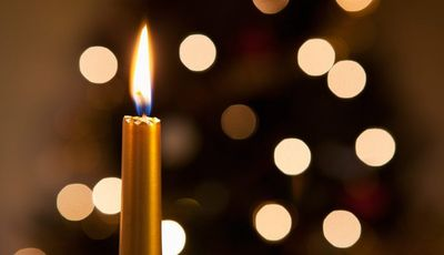 1140-candle-lights-holiday-grief-family.imgcache.rev.web.700.403.jpg