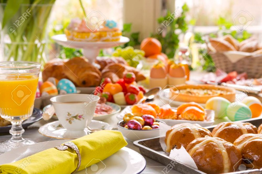 93561821-breakfast-or-brunch-table-filled-with-all-sorts-of-delicious-delicatessen-ready-for-an-easter-meal-.jpg