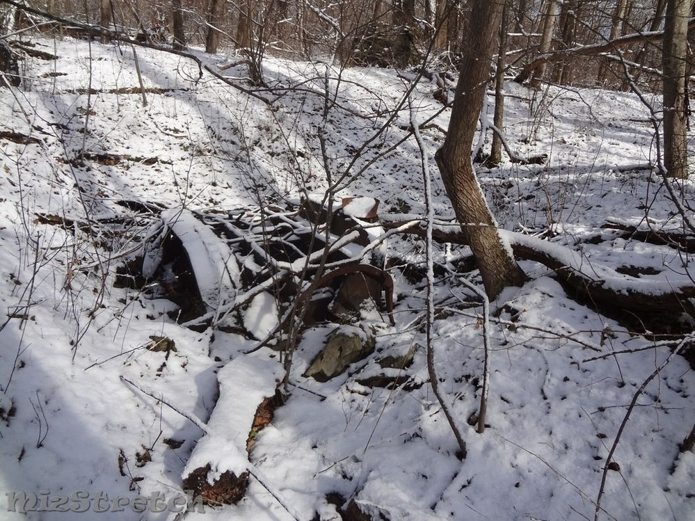 This abandoned upside-down vehicle was found down an old road trace.