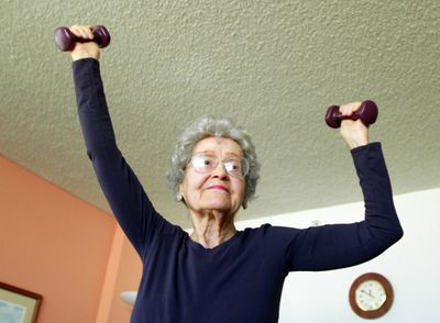 senior woman with hand weights.jpg