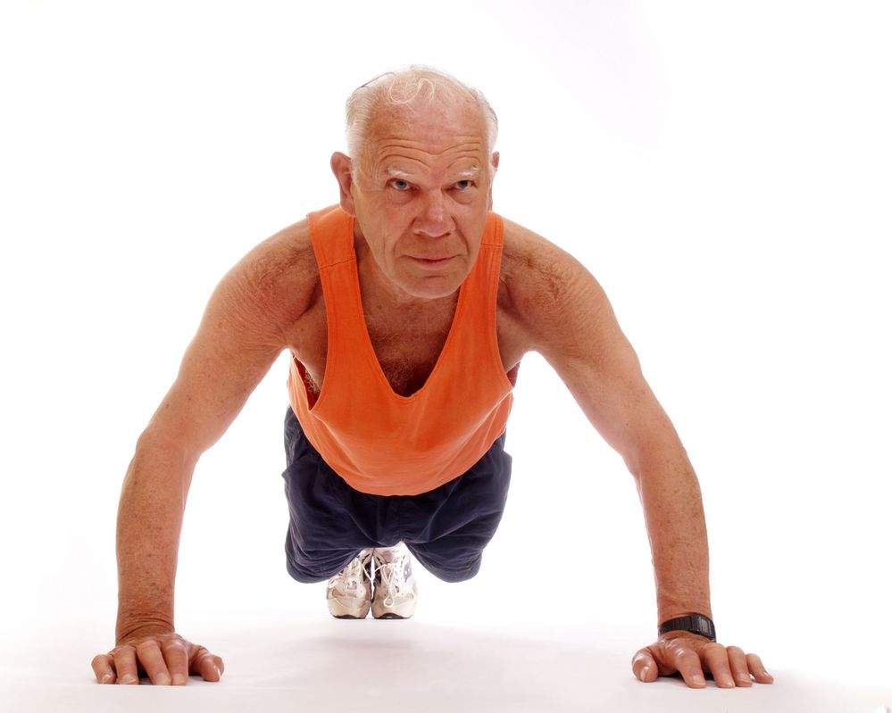 senior man doing push ups.jpg