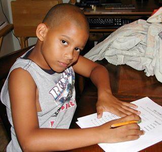 Doing homework, erasing a pencil mark.