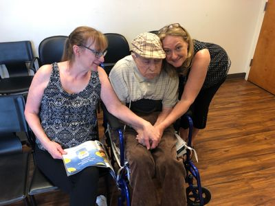 Dad Amy Linda at Dr. Milligan office 6-6-18.jpeg