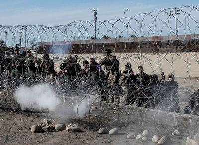 immigrants agents tear gas.jpg
