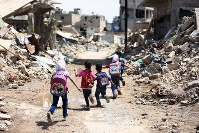 syria warzone to off to school.jpg