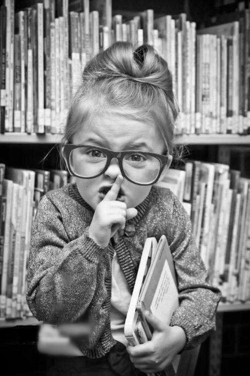 Books - little girl with glasses shushing noisy people.jpg
